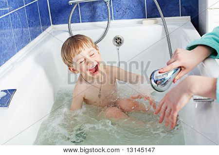 Sweet child taking a bath.