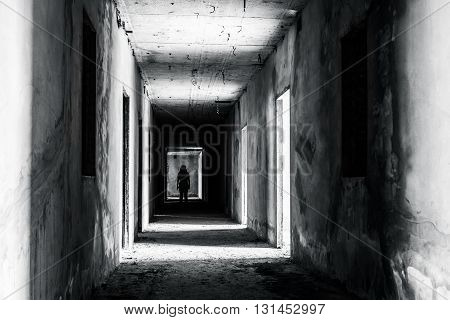 walkway in Abandoned building with scary woman inside darkness horror and halloween background concept