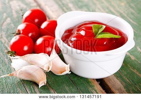 White Bowl With Ketchup With Tomatoes And Garlic