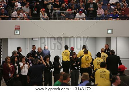 ANAHEIM CALIFORNIA, May 25, 2016: Protesters inside the Anaheim Convention Center cause trouble and try to disrupt Donald J. Trump as he speaks to supporters at his  Presidential rally 5.25.2016
