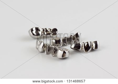 steel dentures made in dental laboratory on a white background