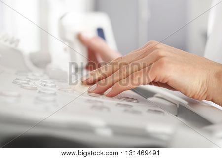 Head sonogram, medical examination. Modern ultrasound equipment