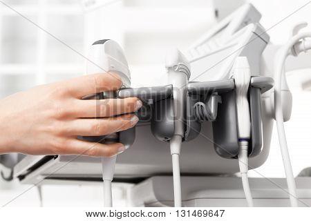 Head sonogram, medical examination. Modern ultrasound equipment.