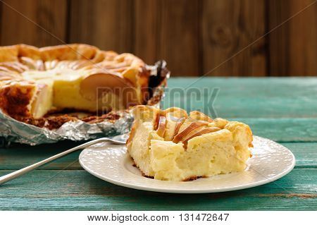 Syrnik homemade quark pie with apples on old wooden table copyspace