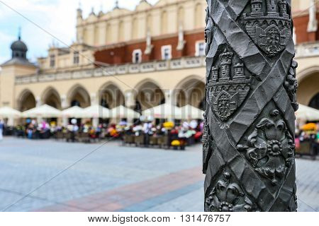 Krakow, Poland- May 25, 2016: Church of Our Lady Assumed into Heaven. Is a Brick Gothic church re-built in the 14th century. With tourists on square