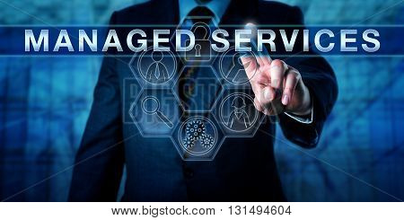 Male business consultant is touching MANAGED SERVICES an a virtual interactive control interface. Information technology concept and business metaphor for outsourcing management responsibility.
