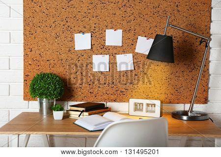 Workplace with stationery on light wooden table.