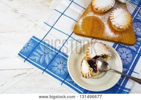 Confiture dessert pie on the white plate. Sweet dessert. Sweet pastry. Small pie. Pie. Jam pie