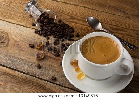 Coffee grains and cup of coffee. Coffee cup. Strong coffee. Coffee mug. Morning coffee. Cup of coffee. Coffee break.