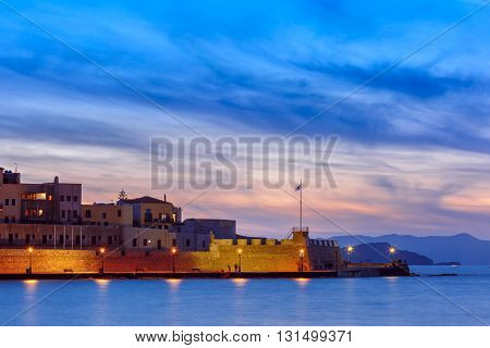 Famouse venetian harbour waterfront of Chania at sunset, Crete, Greece
