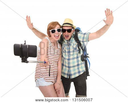 young attractive American couple taking selfie photo portrait together with mobile phone and stick isolated on white background wearing tourist backpack chic hat and sunglasses in trendy look poster