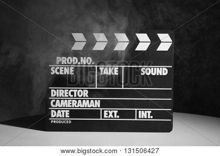 Movie clapper on dark background