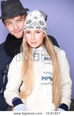 Portrait of embracing young couple in warm clothes.