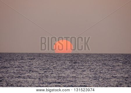 The  Sun Setting In The Sea