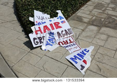 ANAHEIM CALIFORNIA, May 25, 2016: Genuine hand made Protester Sign torn up and discarded  by a Supporter during the Republican Nominee Donald J. Trump Rally Anaheim 5.25.2016