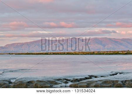 Marshland and Mountains Sunset. Looking at the San Francisco East Bay Mountain Range from Shoreline Park, Mountain View, California