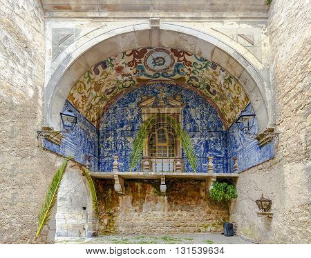 Obidos Portugal - March 20 2016: Porta da Vila is the main entrance of the town of Obidos. This is a double door in spill with tiled inside eighteenth century
