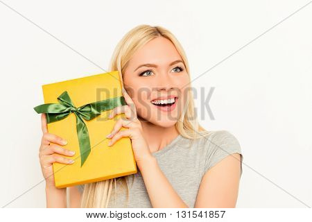 Joyful Cheerful Glad Woman Holding Yellow Gift Box