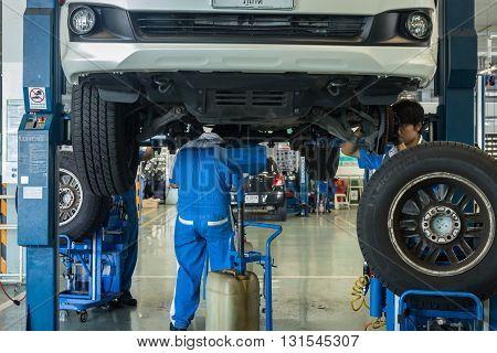 Phuket, Thailand - April 22 : Car Technician Repairing Car In Workshop Service Station In Phuket On