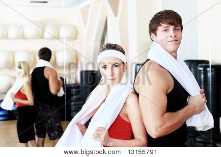 Couple of a sporty young people in the gym centre.