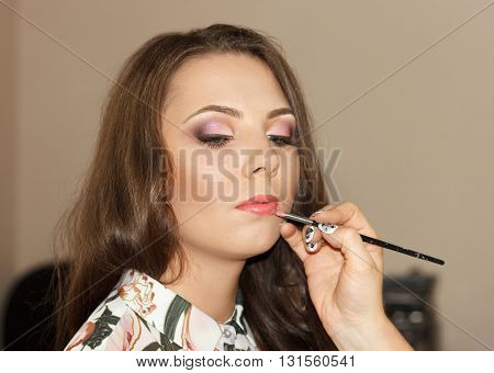 Make-up for the young brunette nice girl