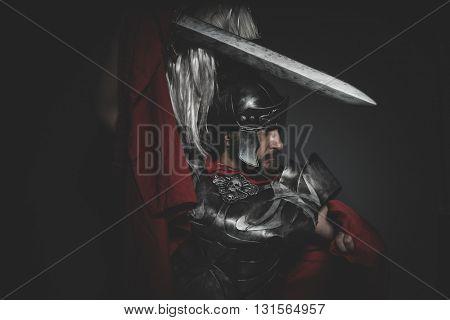 Fighter, Praetorian Roman legionary and red cloak, armor and sword in war attitude