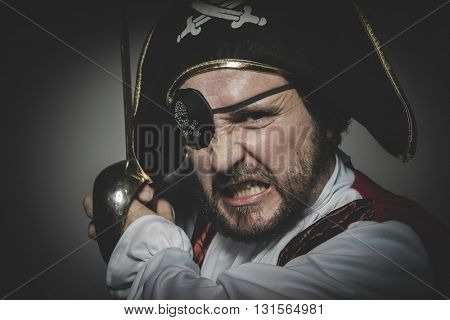 Costume. man pirate with eye patch and old hat with funny faces and expressiveCostume. man pirate with eye patch and old hat with funny faces and expressive