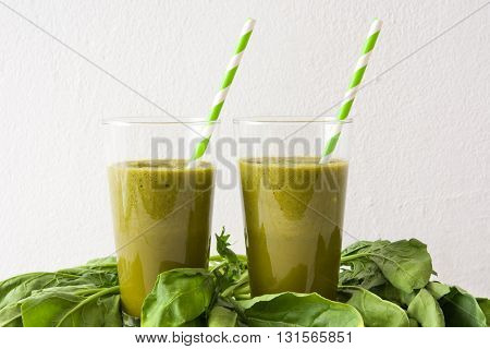 Healthy green detox with spinach, cucumber, lime and apples on white wooden table