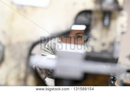 Closeup of woman working in metallurgy factory