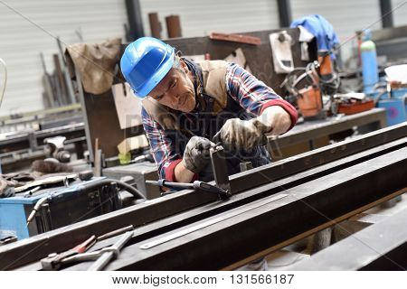 Man working in steelwork factory