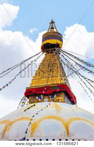 Bodhnath stupa in Kathmandu with buddha eyes and prayer flags on clear blue sky background Nepal 2014