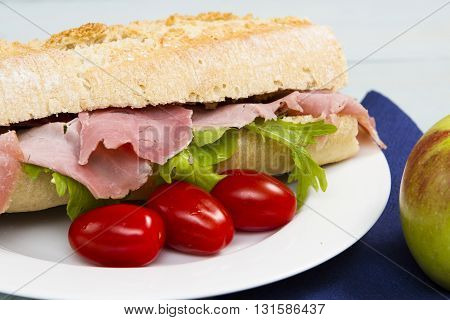 baguette Half a French baguette stuffed with ham and lettuce as a snack