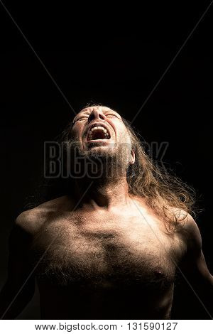adult long haired Men with nude upper body screaming