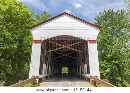 Historic Jackson Covered Bridge built in 1861 crosses Sugar Creek in rural Parke County Indiana.