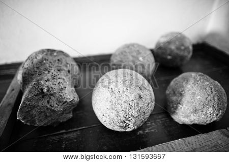 Archaeological Find, Round Stones And Shapeless Form. Black And White