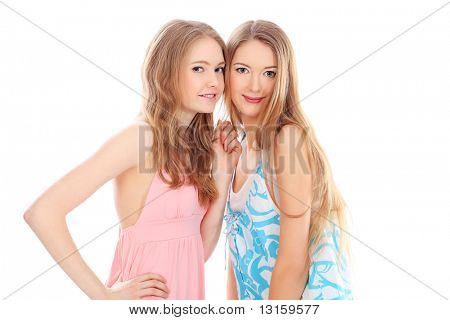 Two happy girls friends. Isolated over white background.