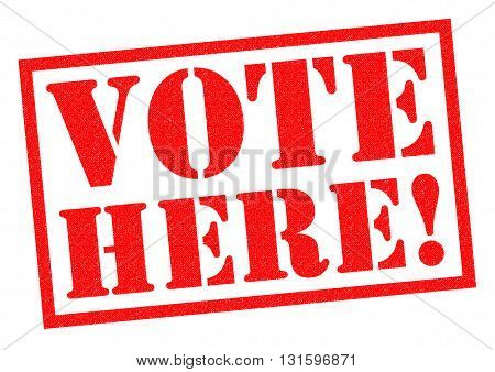 VOTE HERE! red Rubber Stamp over a white background.