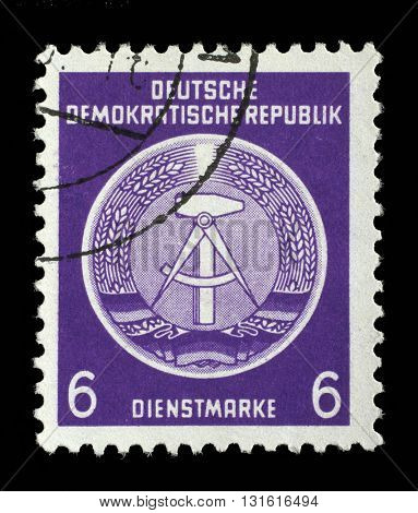 ZAGREB, CROATIA - SEPTEMBER 05: A Stamp printed in GDR (German Democratic Republic - East Germany) shows DDR national coat of arms, circa 1952, on September 05, 2014, Zagreb, Croatia
