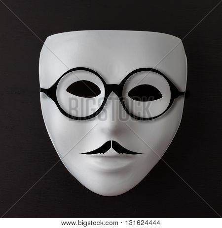White Mask On Black With Mustache And Glasses