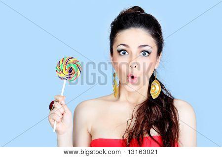 Portrait of a beautiful girl with big lollipop.