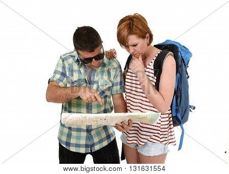 young tourist couple reading city map looking lost and confused loosing orientation with girl carrying travel backpack and man in frustrated face expression isolated white background