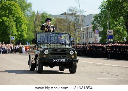 Orel Russia - May 9 2016: Celebration of 71th anniversary of the Victory Day (WWII). Commanders in chief saluting from military car in parade