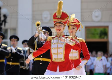 Orel Russia - May 9 2016: Celebration of 71th anniversary of the Victory Day (WWII). Hussars dressing dancers and military brass band
