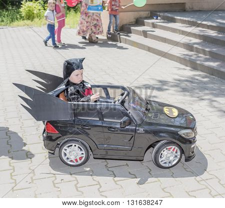 Rostov-on-Don Russia- May 22, 2016: The child dressed as Batman in the car in the park named after V. Cherevichkin