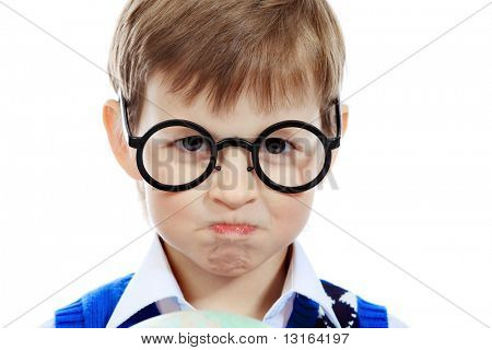 Portrait of a little boy in a funny glasses. Isolated over white background.