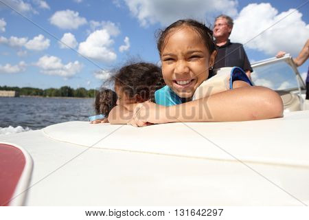 People riding in a boat on an inland lake