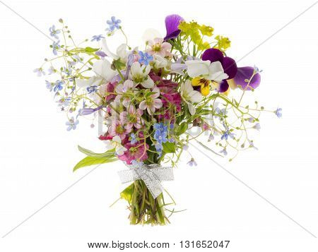 many bright beautiful varietal unusual multicolored flowers in spring beautiful bouquet bound with silver ribbon isolated on white background