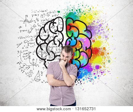 Right and left hemispheres creative and analytical thinking concept with thoughtful man standing against concrete wall with sketch