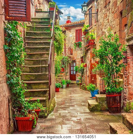 Colorful alley in old town Tuscany, Italy