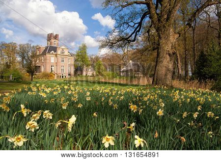 Oldenaller castle near the Dutch village Putten surrounded by daffodils